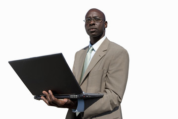 Businessman with laptop computer, cut out