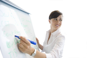 Woman writing on whiteboard, cut out