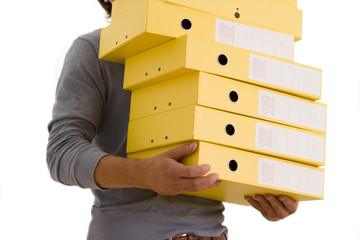 Man with pile of box files, mid section, cut out