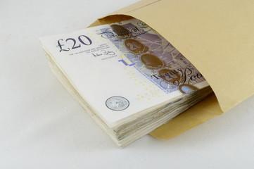Twenty pound notes in brown envelope