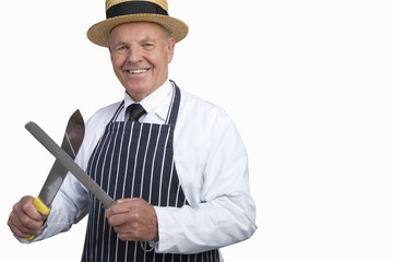 Butcher in uniform sharpening knife, cut out