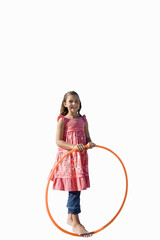 Girl with plastic hoop, smiling, portrait, cut out
