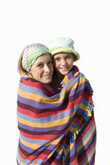 Mother and daughter wrapped in blanket, smiling, portrait, cut out