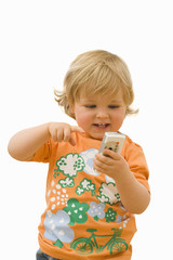 Toddler playing with mobile phone, smiling, cut out