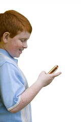 Boy with mobile phone, smiling, side view, cut out