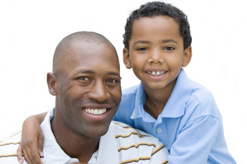 Portrait of father and son smiling, close-up, cut out