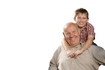 Portrait of boy hugging grandfather, cut out