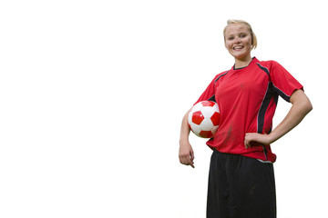 Portrait of teenage girl in uniform holding soccer ball, cut out