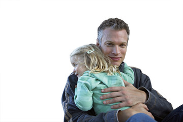 Father embracing daughter, smiling, cut out