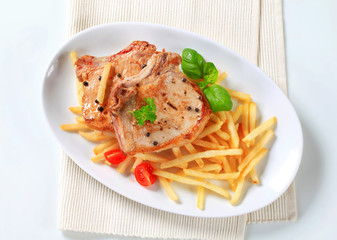 Pan fried pork chop with fries