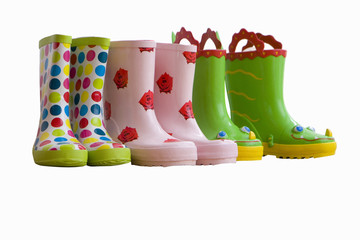 Three pairs of children's coloured rubber boots, cut out