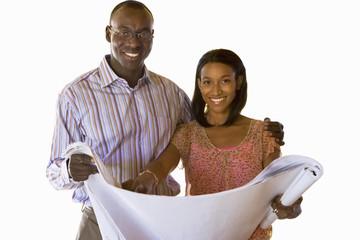 Young couple with blueprints, smiling, portrait, cut out