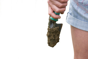 Woman with dirty trowel, cut out