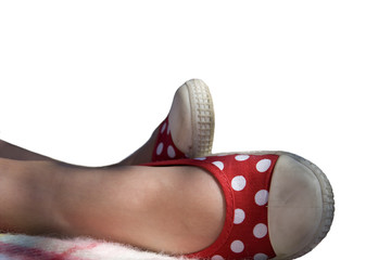 Close up of girl's feet with red shoes, cut out
