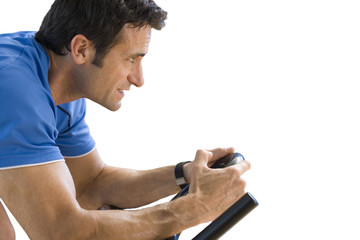 man on exercise bike, cut out
