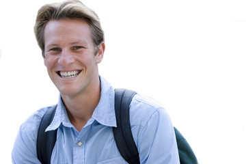 close-up of man smiling, wearing rucksack, cut out