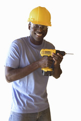 man in construction helmet and goggles holding drill, cut out
