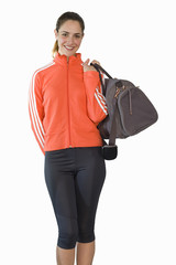 young woman holding kit bag, cut out