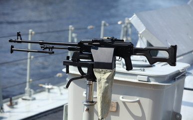 machine gun on the side of a Navy warship