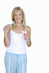 young woman in pyjamas cleaning teeth, cut out