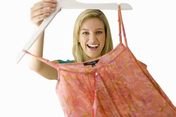 girl holding item of clothing on hanger, cut out