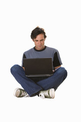 man with crossed legs working on laptop, cut out