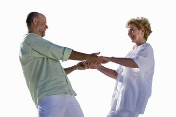 senior couple holding hands, dancing, cut out