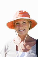 close-up of senior woman in sun hat, cut out