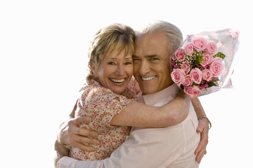senior couple hugging, bunch of roses, cut out