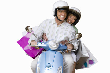 senior couple riding on scooter, cut out