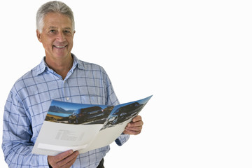senior man holding car brochure, cut out