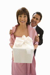 couple at wedding holding wrapped gift, cut out