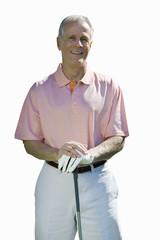 senior man leaning on golf club, cut out