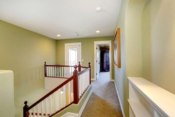 Mint upstairs hallway with white railings