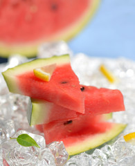 slices of red watermelon and ice cubes
