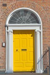 Yellow Georgian door in Dublin Ireland
