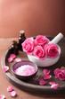 spa set with rose flowers mortar essential oils salt