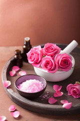 spa set with rose flowers mortar essential oils salt