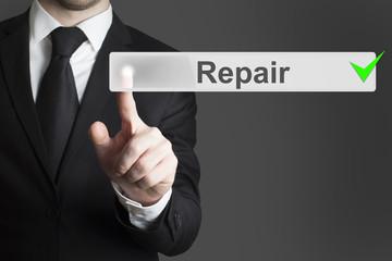 businessman pushing button repair service