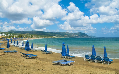 beach with umbrellas and sunbeds