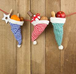 Rustic wooden background with Christmas fruits and decoration