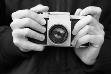 Old film camera in the hands (Black and White)