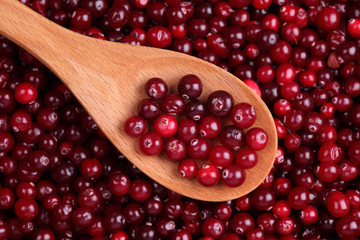 Cranberry in a wooden spoon