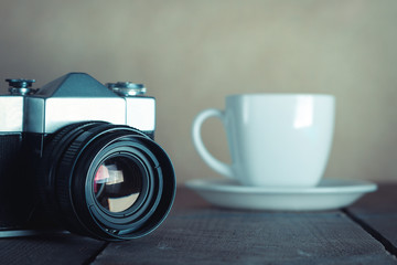 Old Camera And White Cup