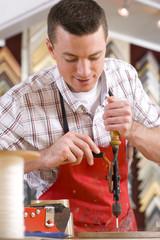 Craftsman working on frame in frame shop