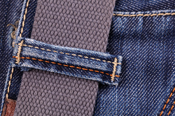 Close-up of blue jeans with belt