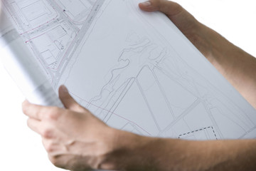 Close of man holding blueprints