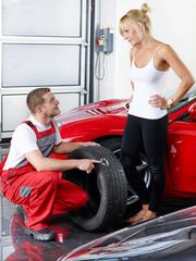Female customer and mechanic in a garage