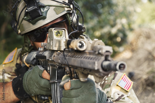 american soldier pointing his rifle - 69337783