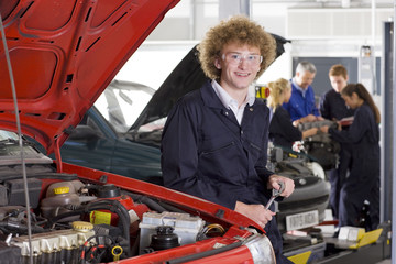 Student repairing car in automotive vocational school